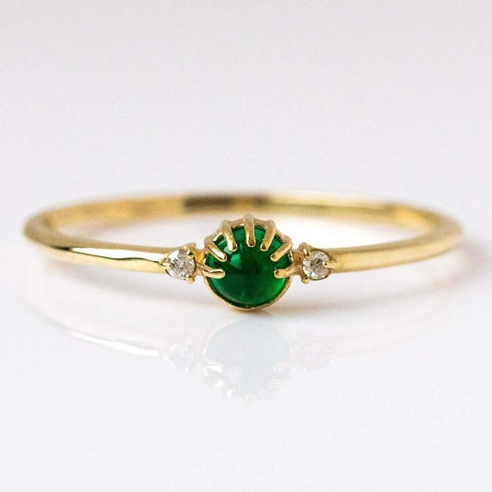 """<h3>Merewif Joyful Eyes Earring</h3> <br>A brilliant emerald nestled in a unique setting — and flanked by two mini diamonds — gives this 10K gold ring a mystical appearance.<br><br><em>Shop <a href=""""https://www.localeclectic.com/"""" rel=""""nofollow noopener"""" target=""""_blank"""" data-ylk=""""slk:Local Eclectic"""" class=""""link rapid-noclick-resp""""><strong>Local Eclectic</strong></a></em><br><br><strong>Merwif</strong> Joyful Eyes Ring with Emerald, $, available at <a href=""""https://go.skimresources.com/?id=30283X879131&url=https%3A%2F%2Fwww.localeclectic.com%2Fcollections%2Ffine-jewelry%2Fproducts%2Fjoyful-eyes-ring-with-emerald"""" rel=""""nofollow noopener"""" target=""""_blank"""" data-ylk=""""slk:Local Eclectic"""" class=""""link rapid-noclick-resp"""">Local Eclectic</a><br><br><br>"""
