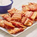 """<p>We aren't sure what makes these so crazy addictive but we can't stop once we start. This is the easiest party food to whip together (it even works in the air fryer!) and everyone will love it. Three simple ingredients come together in an hour and turn any gathering into a party! </p><p>Get the <a href=""""https://www.delish.com/uk/cooking/recipes/a29707548/bacon-crack-bites-recipe/"""" rel=""""nofollow noopener"""" target=""""_blank"""" data-ylk=""""slk:Bacon Crack Bites"""" class=""""link rapid-noclick-resp"""">Bacon Crack Bites</a> recipe.</p>"""