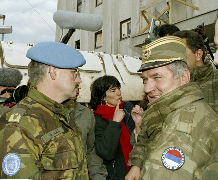 FILE - In this April 9, 1994 file photo, former Bosnian Serb commander Ratko Mladic, right, leaves the UN headquarters at Sarajevo airport after talks with the UN General, Sir Michael Rose and Bosnian Commander Rasim Delic. U.N. judges will on Tuesday, June 8, 2021 deliver their final ruling on the conviction of former Bosnian Serb army chief Ratko Mladic on charges of genocide, war crimes and crimes against humanity during Bosnia's 1992-95 ethnic carnage. (AP Photo/Enric Marti, File)