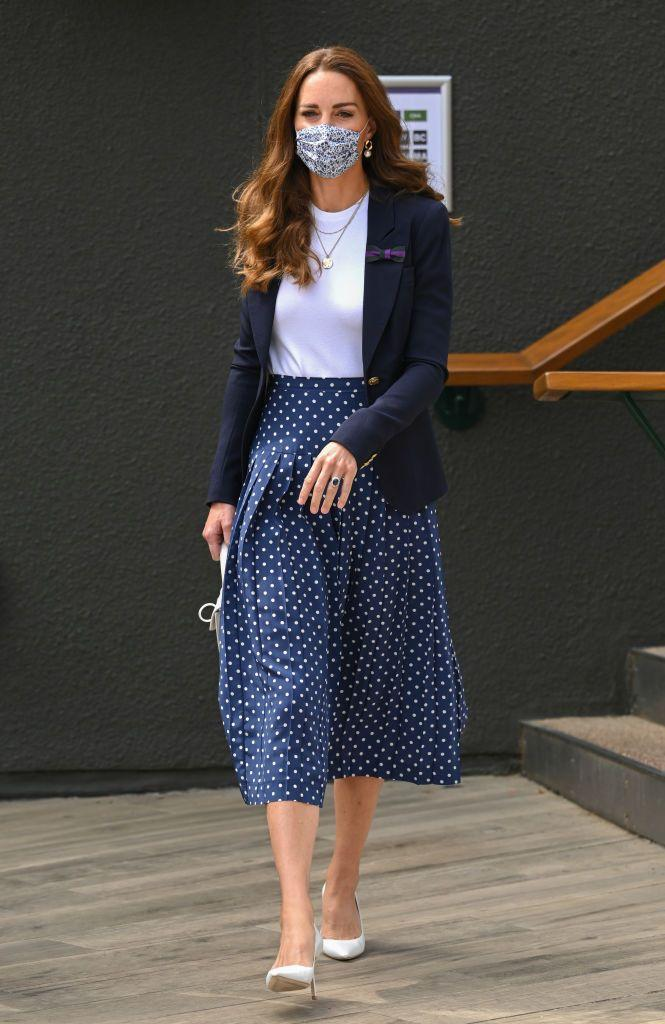 <p>The tennis fan arrived on Day five of the 2021 tournament, the Duchess of Cambridge's first visit in two years. </p><p>The mother-of-three wore a polka dot navy midi skirt, a white tee, navy blazer and white pumps and bag to watch a match on one of the outer courts where she sat next to former British tennis player Tim Henman, who now sits on the committee of the All England Tennis and Croquet Club. </p>