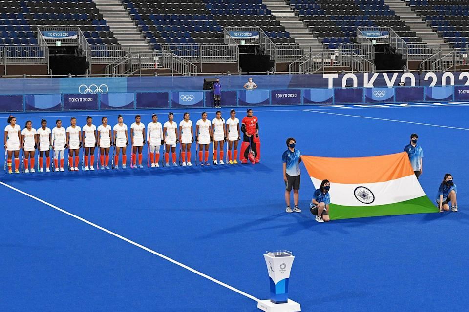 Players of India listen to their national anthem before the women's semi-final match of the Tokyo 2020 Olympic Games field hockey competition against Argentina, at the Oi Hockey Stadium in Tokyo, on August 4, 2021.