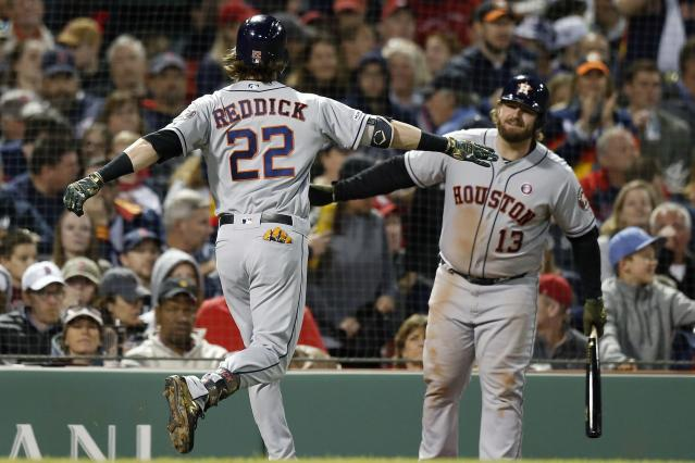 Houston Astros' Josh Reddick (22) celebrates his solo home run with Tyler White (13) during the fifth inning of a baseball game against the Boston Red Sox in Boston, Saturday, May 18, 2019. (AP Photo/Michael Dwyer)