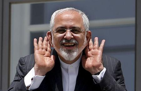 Iranian Foreign Minister Mohammad Javad Zarif gestures as he talks with journalist from a balcony of the Palais Coburg hotel where the Iran nuclear talks meetings are being held in Vienna,