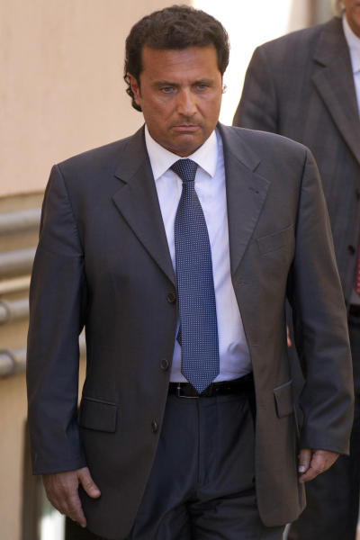 FILE -- In this file photo taken in Grosseto on April 15 2013, former captain of the Costa Concordia luxury cruise ship Francesco Schettino leaves after a closed-door hearing. The Italian captain of the Costa Concordia cruise ship was ordered on Wednesday to stand trial for manslaughter in the luxury liner's shipwreck off the coast of Tuscany, which killed 32 people. Judge Pietro Molino, at a closed door hearing in the town of Grosseto, agreed to prosecutors' requests that Francesco Schettino should be tried on charges of manslaughter, causing the shipwreck and abandoning the vessel while many of the 4,200 passengers and crew were still aboard. (AP Photo/Andrew Medichini)