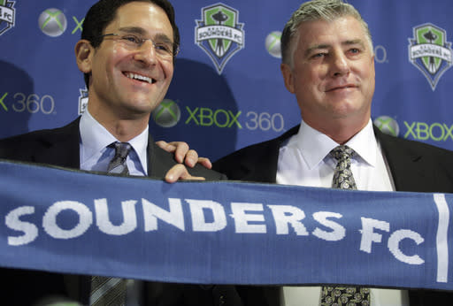 FILE - In this Dec. 16, 2008, file photo, Sigi Schmid, right, is introduced by Seattle Sounders general manager Adrian Hanauer, left, as the first head coach of the Sounders FC MLS soccer team in Seattle. Nearly two years after he died, Schmids presence and influence is being heavily felt heading into Saturdays MLS Cup final between Columbus and Seattle. (AP Photo/Ted S. Warren, File)