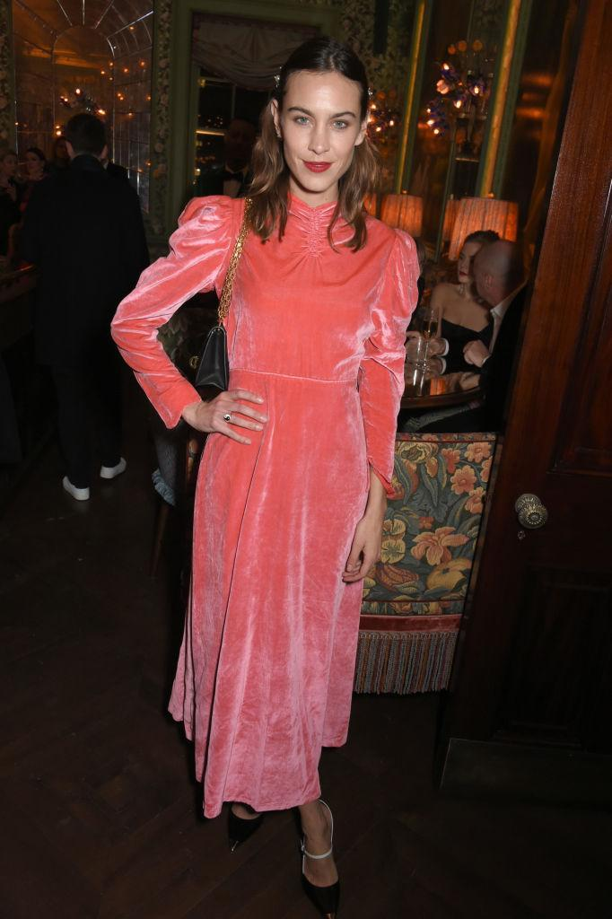 <p>London Fashion Week Queen, Alexa Chung, donned a crushed velvet midi for the Vogue party. <em>[Photo: Getty]</em> </p>