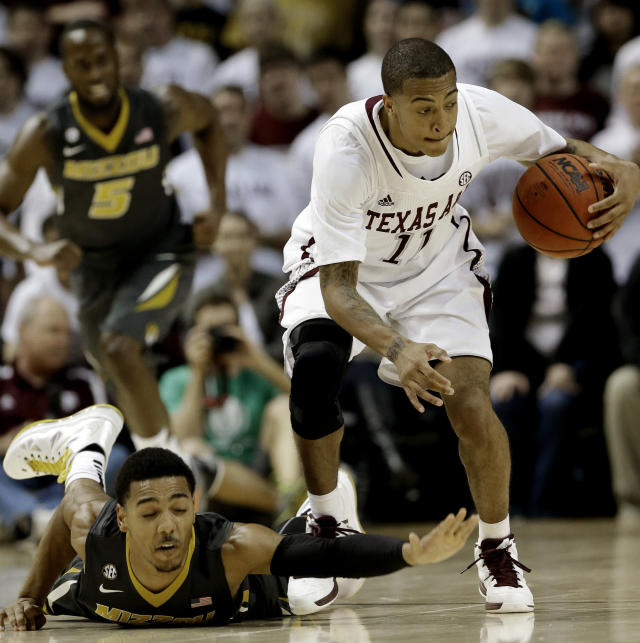Missouri's Phil Pressey, left, tries to get the ball back from Texas A&M's J'Mychal Reese (11) after a turnover during the second half of an NCAA college basketball game Thursday, Feb. 7, 2013, in College Station, Texas. Texas A&M won 70-68. (AP Photo/Pat Sullivan)