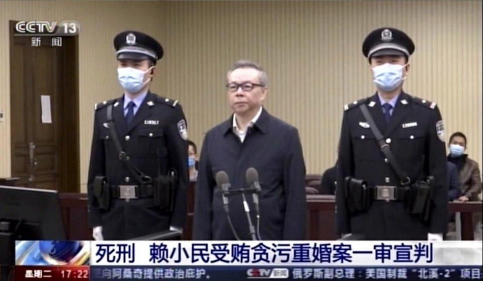 Lai Xiaomin, the former head of the state-owned China Huarong Asset Management, at the Second Intermediate People's Court of Tianjin in China. Photo: CCTV via AP