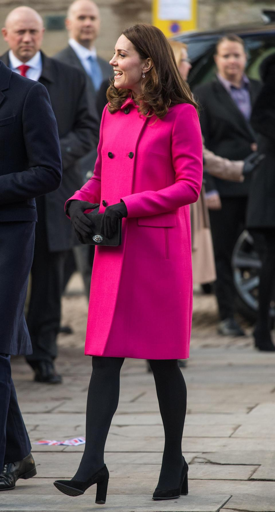 <p><strong>The occassion:</strong> A visit to Coventry Cathedral in Coventry. <br><strong>The look:</strong> A Mulberry double-breasted fucshia coat with the Mulberry Bayswater clutch, Tod's black suede pumps and Kiki McDonough drop earrings. <br>[Photo: Getty] </p>