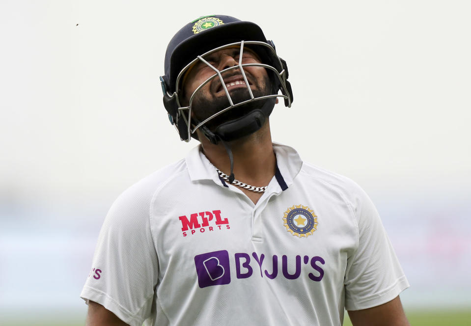 India's Rishabh Pant reacts as he leaves the field after he was dismissed during play on day two of the second cricket test between India and Australia at the Melbourne Cricket Ground, Melbourne, Australia, Sunday, Dec. 27, 2020. (AP Photo/Asanka Brendon Ratnayake)