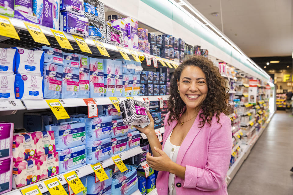 Ash London at the Woolworths Northbridge store holding a period product. Source: Woolworths
