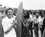 """In this Aug. 18, 1971, image provided by the Richard Nixon Presidential Library and Museum, then-first lady Pat Nixon talks with people in San Diego while people across the border, marked by a barbed wire fence, watch from the Tijuana, Mexico, side during the dedication of Friendship Park. In the days before Joe Biden became president, construction crews worked quickly to finish Donald Trump's wall at an iconic cross-border park overlooking the Pacific Ocean that then-first lady Pat Nixon inaugurated in 1971 as a symbol of international friendship. Biden on Wednesday, Jan. 20, 2021, ordered a """"pause"""" on all wall construction within a week, one of 17 executive edicts issued on his first day in office, including six dealing with immigration. (Courtesy of Richard Nixon Presidential Library and Museum via AP)"""