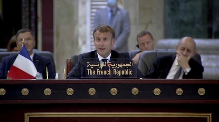 A photo released by the Iraqi Prime Minister Media Office shows French President Emmanuel Macron attends the Baghdad Conference for Cooperation and Partnership in Baghdad, Saturday, Aug. 28, 2021. (Iraqi Prime Minister Media Office, via AP)