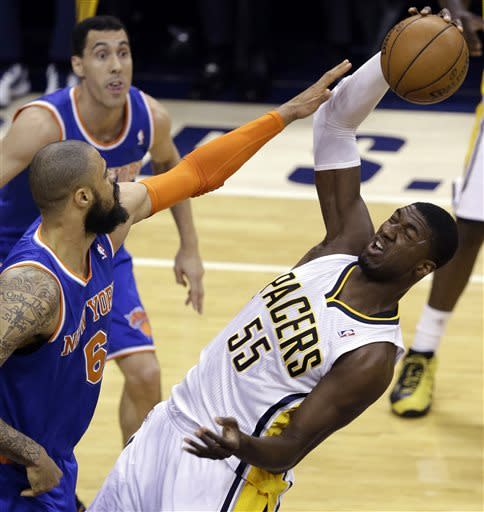 Indiana Pacers center Roy Hibbert, right, is fouled by New York Knicks center Tyson Chandler (6) when grabbing a rebound during the first quarter of Game 6 of the Eastern Conference semifinal NBA basketball playoff series in Indianapolis, Saturday, May 18, 2013. (AP Photo/Michael Conroy)