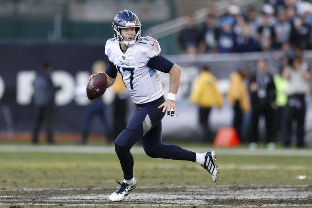 Tennessee Titans quarterback Ryan Tannehill (17) rolls out to pass against the Oakland Raiders during the second half of an NFL football game in Oakland, Calif., Sunday, Dec. 8, 2019. (AP Photo/D. Ross Cameron)