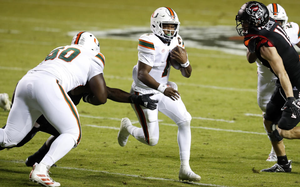 Miami quarterback D'Eriq King (1) accounted for six TDs against North Carolina State. (Ethan Hyman/The News & Observer via AP, Pool)
