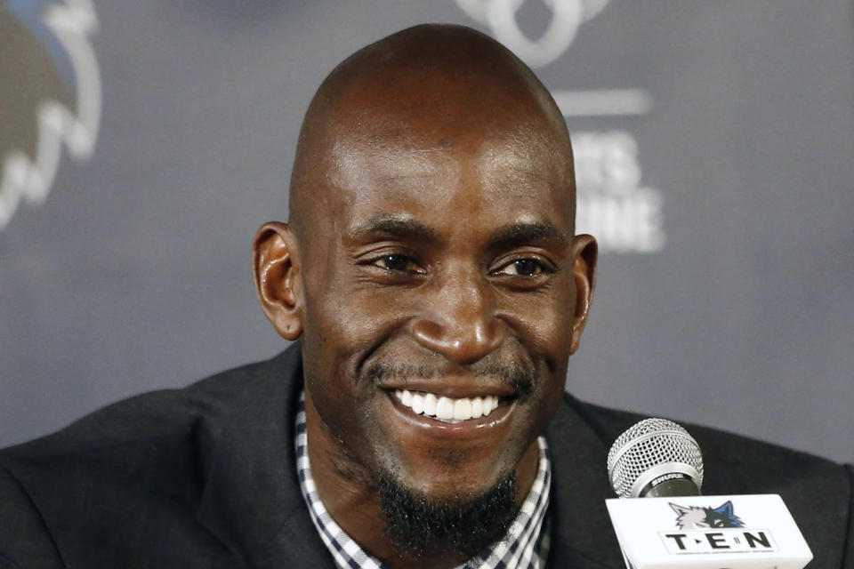 FILE - In this Feb. 24, 2015, file photo, Minnesota Timberwolves star Kevin Garnett speaks during an NBA basketball news conference in Minneapolis. Kobe Bryant, Tim Duncan and Kevin Garnett. Each was an NBA champion, an MVP, an Olympic gold medalist, annual locks for All-Star and All-Defensive teams. And now, the ultimate honor comes their way: On Saturday night, May 15, 2021, in Uncasville, Connecticut, they all officially become members of the Naismith Memorial Basketball Hall of Fame. (AP Photo/Jim Mone, File)