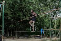 """A tightrope-walker with """"Le Cirque de l'Equateur"""", Gabon's only circus, which has fallen on hard times"""