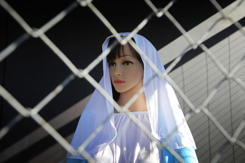 A statue of Mary inside a cage