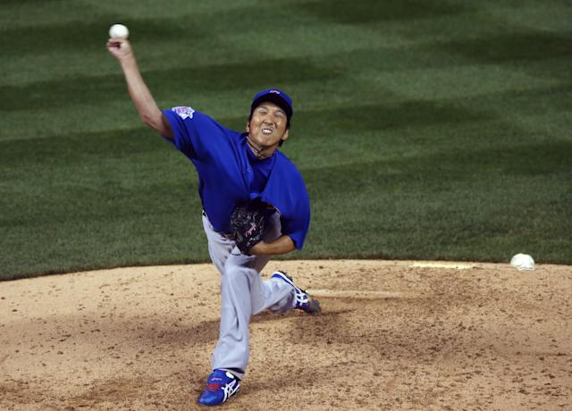 Making his first appearance since Tommy John surgery in June 2013, Chicago Cubs relief pitcher Kyuji Fujikawa works against the Colorado Rockies in the sixth inning of a baseball game in Denver on Wednesday, Aug. 6, 2014. (AP Photo/David Zalubowski)