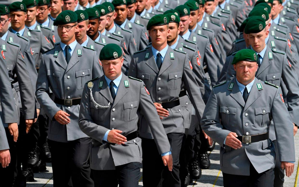 New recruits march on the parade ground during a swearing-in ceremony of German Bundeswehr soldiers at the German Defence Ministry in Berlin, on July 20, 2019 - AFP
