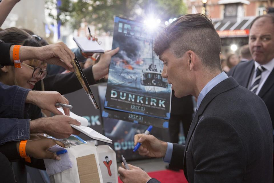 <p>Cillian Murphy signs autographs for the crowd (WB) </p>