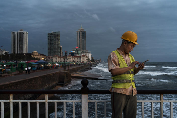 A Chinese construction worker speaks during a video chat with his wife on the WeChat messaging app in Colombo, Sri Lanka, June 1, 2018. (Adam Dean/The New York Times)