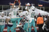 Miami Dolphins tight end Mike Gesicki, left, celebrates his winning touchdown catch with Albert Wilson, right, in the second half of an NFL football game against the New England Patriots, Sunday, Dec. 29, 2019, in Foxborough, Mass. (AP Photo/Elise Amendola)