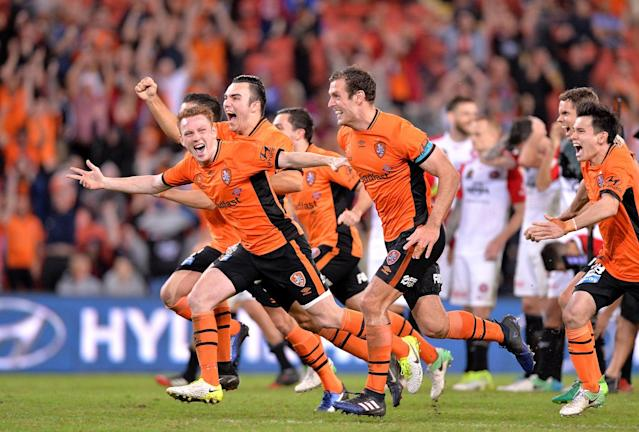 <p>Brisbane Roar celebrate a dramatic penalty-shootout win over Western Sydney Wanderers in the A League play-offs </p>