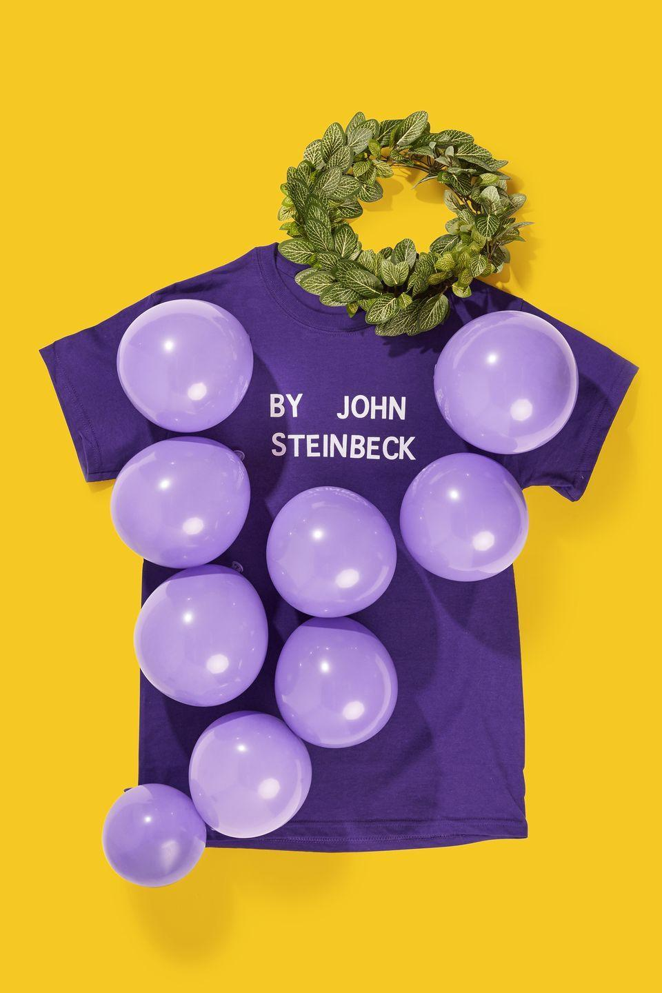 """<p>Book lovers, this is the costume for you. Spell out """"By John Steinbeck"""" on a purple t-shirt with white adhesive letters, then safety pin purple balloons onto the shirt. Create a vine crown by hot-gluing faux vines together to complete your look. </p><p><a class=""""link rapid-noclick-resp"""" href=""""https://www.amazon.com/Chenkou-Craft-Artificial-Foliage-Garland/dp/B01EROCCEQ?tag=syn-yahoo-20&ascsubtag=%5Bartid%7C10070.g.490%5Bsrc%7Cyahoo-us"""" rel=""""nofollow noopener"""" target=""""_blank"""" data-ylk=""""slk:SHOP FAKE VINE FOLIAGE"""">SHOP FAKE VINE FOLIAGE</a> </p>"""