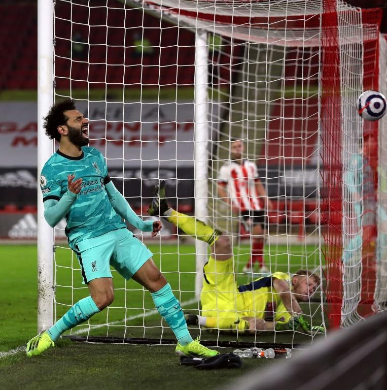 Sloppy Salah: Mohamed Salah (left) reacts angrily to missing a chance in Liverpool's 2-0 win at Sheffield United