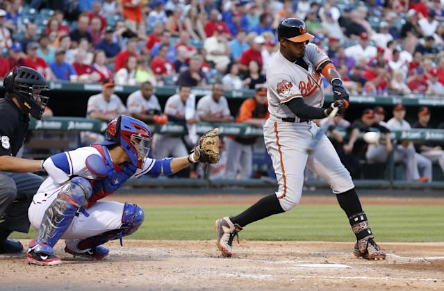 Texas Rangers catcher Robinson Chirinos watches from behind the plate as Battimore Orioles' Adam Jones hits a home run in the fourth inning of a baseball game Tuesday, June 3, 2014, in Arlington, Texas. (AP Photo/Sharon Ellman)