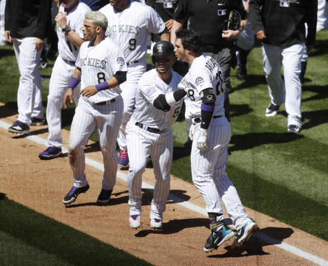 Colorado Rockies' Nolan Arenado, front right, is restrained by Carlos Gonzalez, center, during Wednesday's brawl. (AP Photo/David Zalubowski)