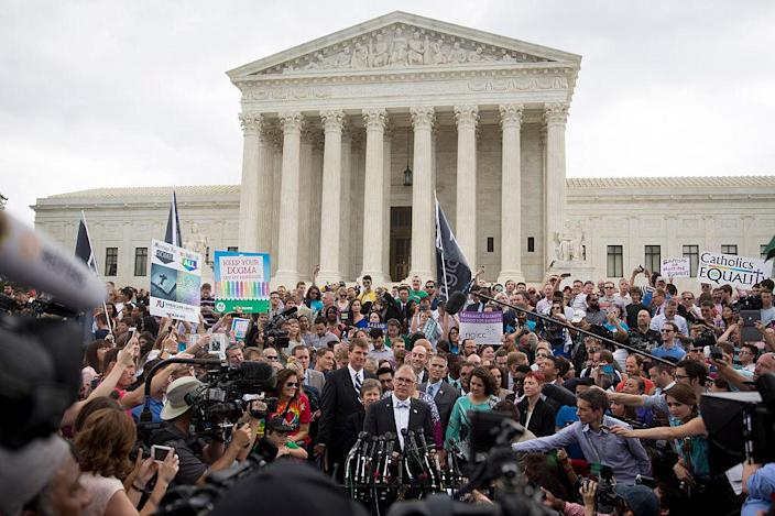 Plaintiff Jim Obergefell, bottom center, speaks to the media outside the Supreme Court after the Obergefell vs. Hodges gay marriage ruling on Friday, June 26, 2015.  (Andrew Harrer / Bloomberg via Getty Images)