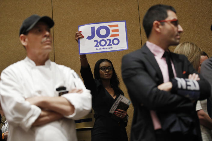 Casino workers and other supporters of Democratic presidential candidate former Vice President Joe Biden caucus at the Bellagio hotel-casino, Saturday, Feb. 22, 2020, in Las Vegas. (AP Photo/John Locher)
