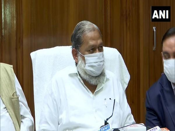 Haryana Home Minister Anil Vij speaking at a press conference on Monday.