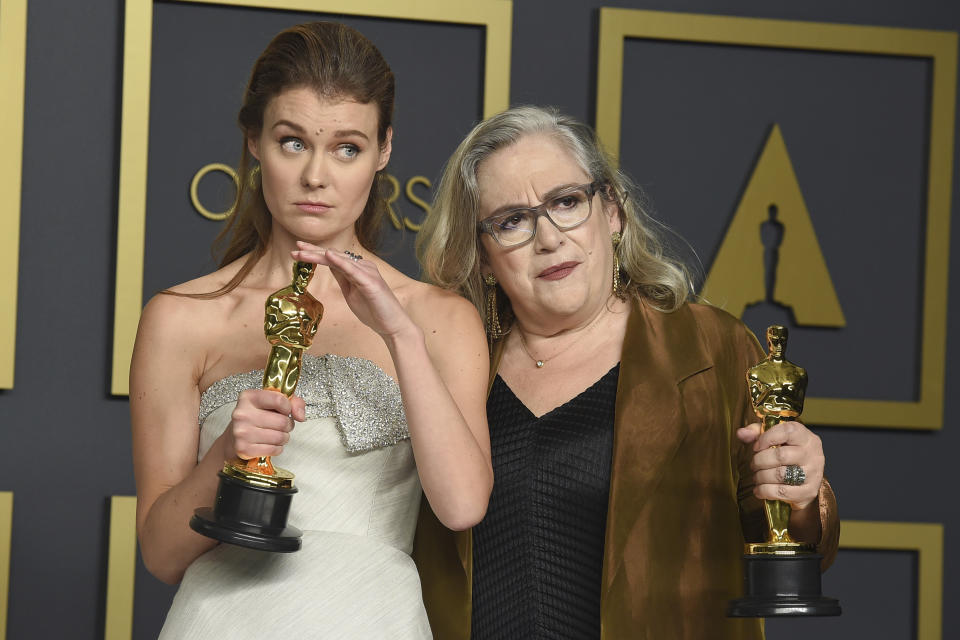 """Elena Andreicheva, left, and Carol Dysinger, winners of the award for best documentary short subject for """"Learning to Skateboard in a Warzone (If You're a Girl)"""", pose in the press room at the Oscars on Sunday, Feb. 9, 2020, at the Dolby Theatre in Los Angeles. (Photo by Jordan Strauss/Invision/AP)"""