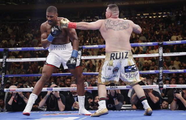 Andy Ruiz Jr. punches Anthony Joshua during the third round of their heavyweight title boxing match June 1, 2019, in New York. (AP Photo/Frank Franklin II)