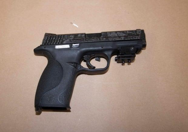 Halifax police say they seized this handgun during the arrest of Andrew Jason Hudder, 34, on Saturday. (Halifax Regional Police - image credit)