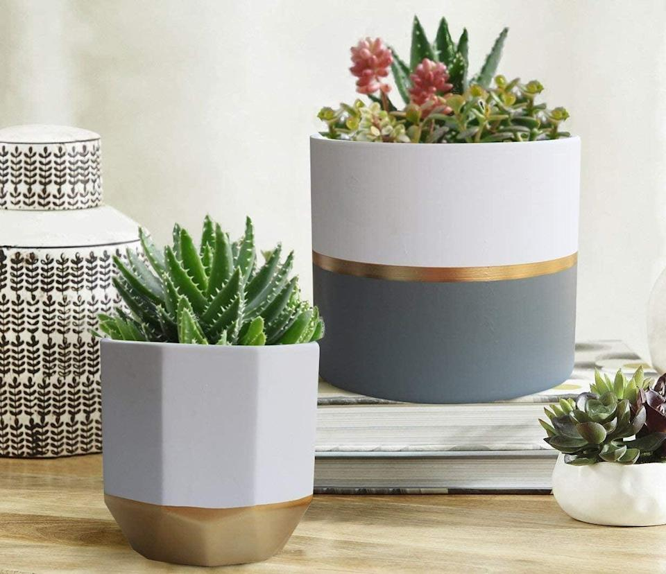 "<p>Get this <a href=""https://www.popsugar.com/buy/White-Ceramic-Flower-Pot-Garden-Planters-581166?p_name=White%20Ceramic%20Flower%20Pot%20Garden%20Planters&retailer=amazon.com&pid=581166&price=50&evar1=casa%3Aus&evar9=45784601&evar98=https%3A%2F%2Fwww.popsugar.com%2Fhome%2Fphoto-gallery%2F45784601%2Fimage%2F47575658%2FWhite-Ceramic-Flower-Pot-Garden-Planters&list1=shopping%2Cproducts%20under%20%2450%2Cdecor%20inspiration%2Caffordable%20shopping%2Chome%20shopping&prop13=api&pdata=1"" class=""link rapid-noclick-resp"" rel=""nofollow noopener"" target=""_blank"" data-ylk=""slk:White Ceramic Flower Pot Garden Planters"">White Ceramic Flower Pot Garden Planters</a> ($50) for plants in your kitchen.</p>"