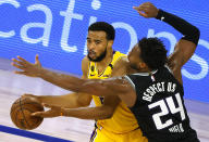 Sacramento Kings' Buddy Hield (24) defends against Los Angeles Lakers' Talen Horton-Tucker (5) during the fourth quarter of an NBA basketball game Thursday, Aug. 13, 2020, in Lake Buena Vista, Fla. (Kevin C. Cox/Pool Photo via AP)