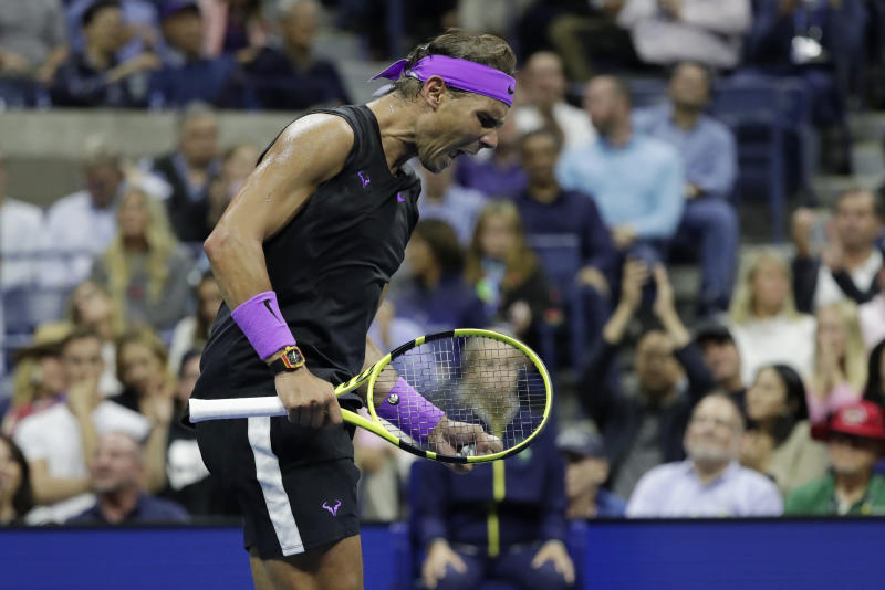 Rafael Nadal, of Spain, reacts after scoring a point against Matteo Berrettini, of Italy, during the men's singles semifinals of the U.S. Open tennis championships Friday, Sept. 6, 2019, in New York. (AP Photo/Adam Hunger)
