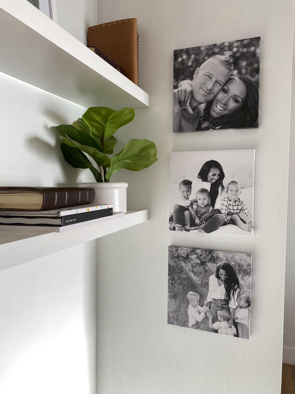 This photo provided by Chatbooks shows their photo wall tiles. Chatbooks lets you connect your Instagram or camera roll to create beautiful photo books, prints, cards – or these lovely wall tiles. Your color or b&w images are printed on square canvas frames equipped with moveable adhesive backing, perfect for renters and owners. (Chatbooks via AP)