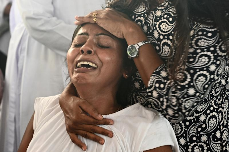 At least 321 people were killed after suicide bomb blasts ripped through three hotels and three churches as worshippers attended Easter services (AFP Photo/Jewel SAMAD)