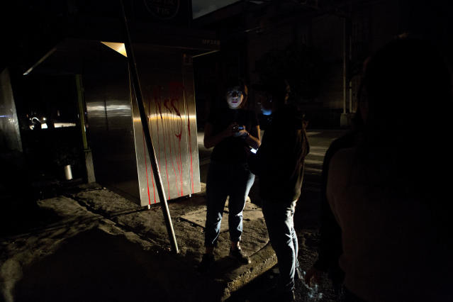 <p>People who evacuated from bars check their phones in the street in La Roma neighborhood of Mexico City, after an earthquake shook buildings forcefully and knocked out power in the area, just before midnight on Thursday, Sept. 7, 2017. (AP Photo/Rebecca Blackwell) </p>
