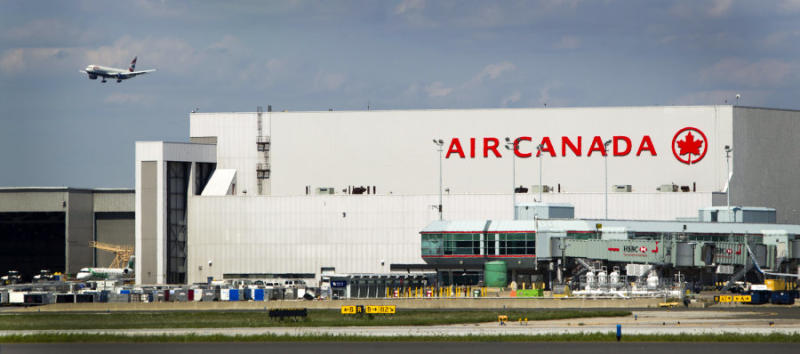 A plane passes over an Air Canada hangar at Toronto Pearson International Airport on Aug. 30, 2011.