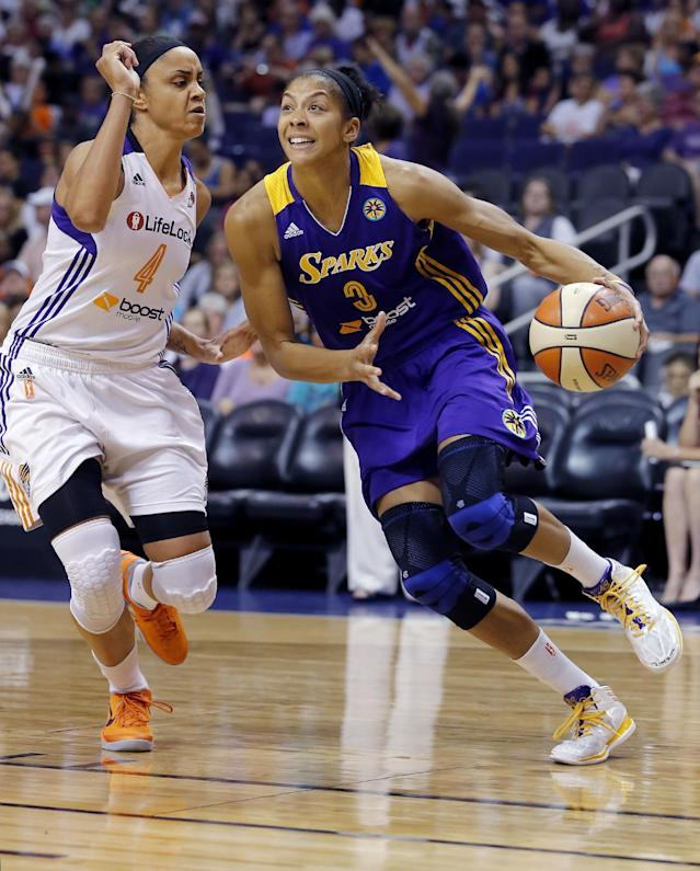 Phoenix Mercury's Candice Dupree (4) defends as Los Angeles Sparks' Candace Parker (3) drives during the first half of Game 2 of a WNBA basketball Western Conference semifinal series, Saturday, Sept. 21, 2013, in Phoenix. (AP Photo/Matt York)