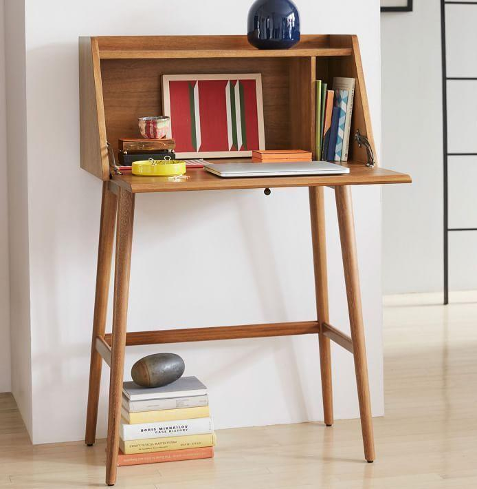 "<p><strong>West Elm</strong></p><p>westelm.com</p><p><strong>$449.00</strong></p><p><a href=""https://go.redirectingat.com?id=74968X1596630&url=https%3A%2F%2Fwww.westelm.com%2Fproducts%2Fmid-century-mini-secretary-h2096%2F&sref=https%3A%2F%2Fwww.esquire.com%2Flifestyle%2Fg35842602%2Fmothers-day-gifts-for-wife%2F"" rel=""nofollow noopener"" target=""_blank"" data-ylk=""slk:Buy"" class=""link rapid-noclick-resp"">Buy</a></p><p>After this year, the best gift you could get your wife might be space. If she doesn't have a desk, and your home doesn't have a ton of square footage, she'll get that space with this secretary desk.</p>"