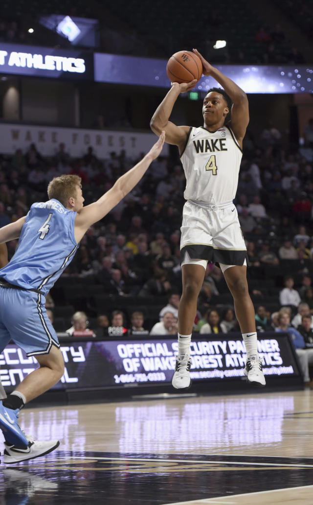 Wake Forest's Jahcobi Neath prepares to sink a basket under pressure from Columbia's Jack Forrest in the first half of an NCAA college basketball game, Sunday, Nov. 10, 2019, in Winston-Salem, N.C. (Walt Unks/Winston-Salem Journal via AP)