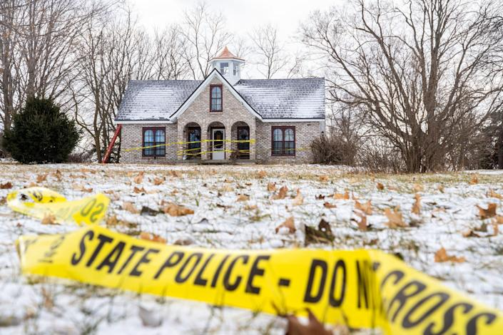 Police tape remains around the home of Mark Latunski on Jan. 8. Latunski is accused of killing and eating parts of his Grindr date, Kevin Bacon.